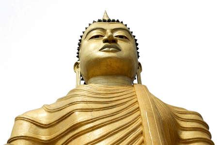 Buddha statue in gold, bottom view. Isolated on white background. Dickwella, Sri Lanka.
