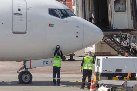 Airport ground staff fills the service panel on the plane with water. Handling and preparing for departure. Tbilisi, Georgia: 2019-04-10