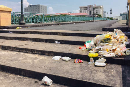 Vietnam, Ho Chi Minh City, 2019-10-04: trash on the street - a bunch of used plastic dishes on a city street Sajtókép