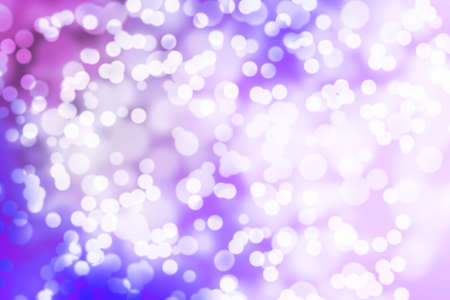 Glowing neon background with blurry bokeh lights. Defocused festive abstract background