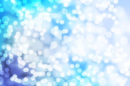Festive blue background with blurry bokeh lights. Defocused abstract background Reklamní fotografie