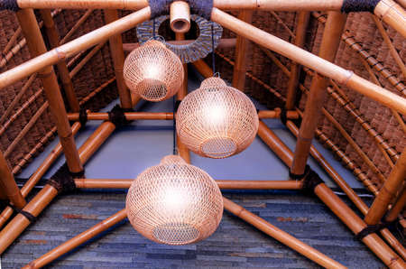 Modern ceiling wicker wooden chandelier.  Use of wooden structural elements in a modern interior. Reklamní fotografie