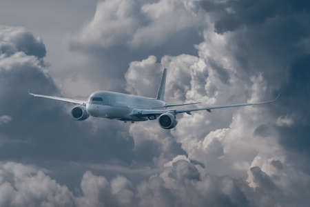 Passenger plane takes off from the stormy dark clouds. The concept of flight in bad  weather