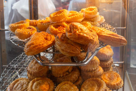 Showcase with puff pastry in a street shop. Photo with shallow depth of focus