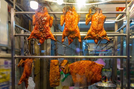 Roasted duck in a counter display case.  Asian street food. Ho Chi Minh, Vietnam