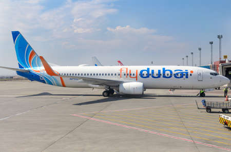 Fly Dubai airplane on the airport platform.  Side view. Tbilisi, Georgia, 2019-04-10