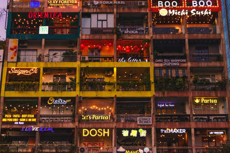 Night view of the facade of the building with various restaurants and shops. 42 Nguyen Hue pedestrian plaza, Ho Chi Minh, Vietnam: 2019-10-08 Redakční