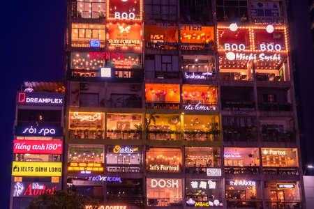 Illuminated advertising billboards and signs at Ho Chi Minh District 1 at night. Nguyen Hue pedestrian plaza. Ho Chi Minh, Vietnam: 2019-10-08