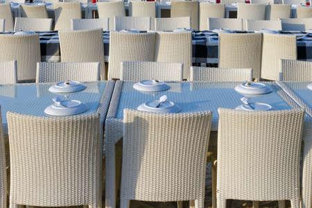Rows of tables in a street restaurant.  Reklamní fotografie