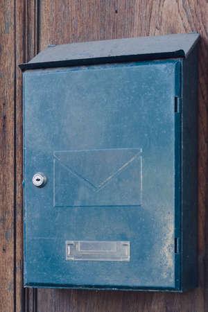 Close up iron mail box on a wooden fence Reklamní fotografie