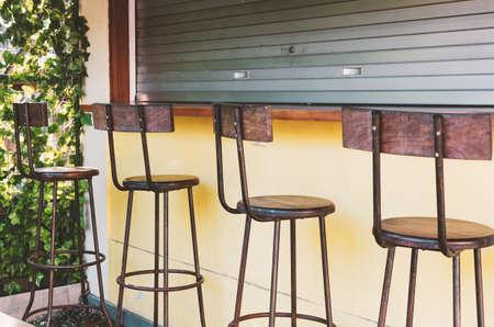 Empty bar - bar stools at the closed bar counter. Small business fail concept Reklamní fotografie