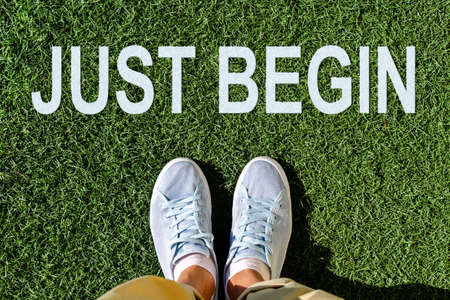 Motivated shoes with inspirational quote  - just begin. Top view selfie legs Reklamní fotografie