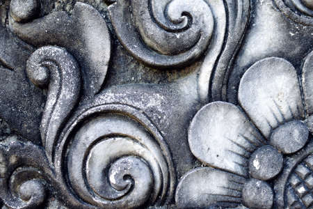 Old wall with relief cement. Balinese decor stone carving.