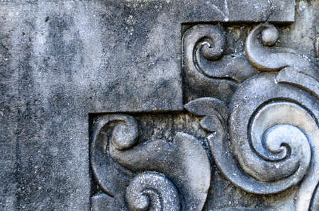 Gray old wall with carved elements. Bali, Indonesia Reklamní fotografie