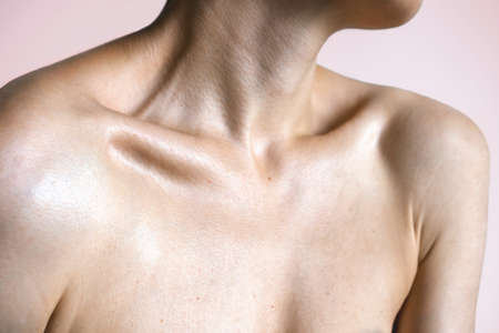 Female graceful forms. Neck shoulders and collarbones of a beautiful woman age 35. Beauty and skin care concept