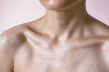 Cropped view at woman chest with middle age skin. Close up