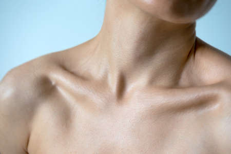 Naked neck shoulders and collarbones of a beautiful woman 35 years old.   Beauty of the female body. Youthfulness concept.