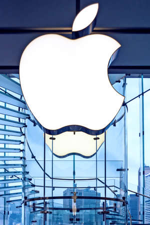 Apple sign on the Apple store glass wall,  close up.  Hong Kong, 2018-03-14. Vertical photo
