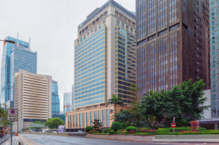 City street in perspective. View of the skyscrapers of the metropolis in the afternoon.  View of the Mandarin Oriental Hotel.  Hong Kong, 2018-03-14 Redakční