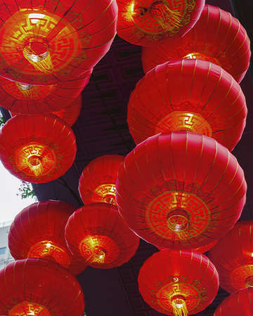 Bottom view of red chinese lanterns.  Traditional decoration of buildings