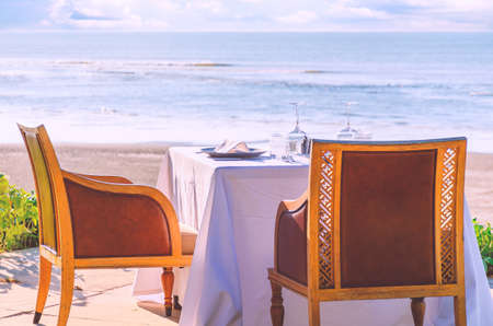 Table in a restaurant  or resort by the sea  beach served for two.