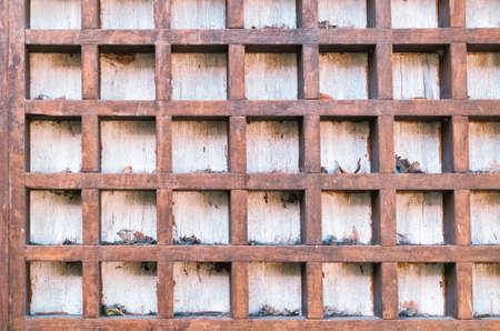 Vintage background with square wooden cells. Reklamní fotografie