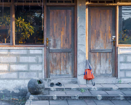 Two wooden entrance doors in a poor village house.  Stock Photo