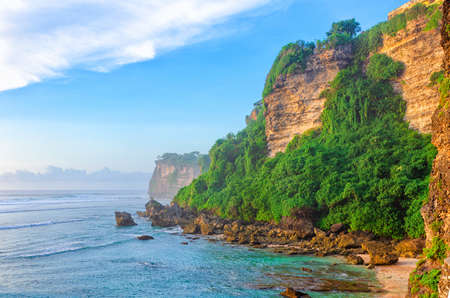 Mountain and beach landscape at indonesian island.   Sunny morning scene of sea shore at Bali, Single Fin. Travel to holiday in Asia concept