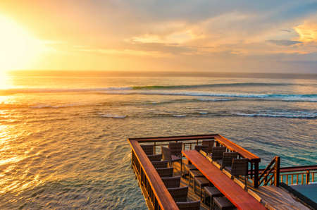 Sunset seascape with water ripple and small waves from the outdoor terrace. Bali, Single fin
