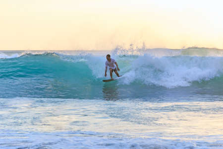 Surfer catches the wave.  Surfer leaves the pipe. Bali island waves.  Bali, 2018-04-21