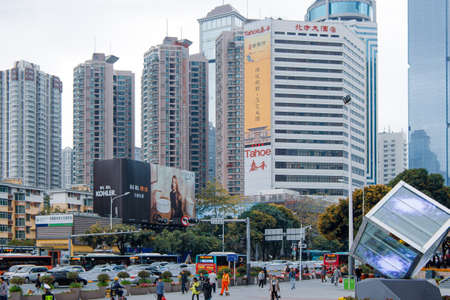 Modern architecture of Shenzhen city business center. Skyscrapers and a stream of cars. Shenzhen, China, 2018-03-08