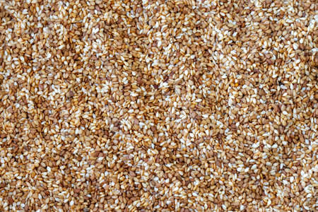 Roasted sesame seeds unpolished background. Top view