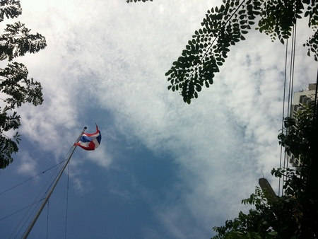 wire: Thailands Flag under blue sky Stock Photo