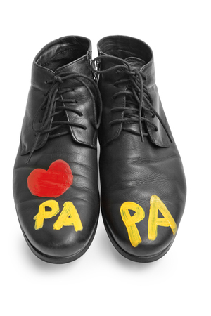 men's: Mens shoes with baby says papa Stock Photo