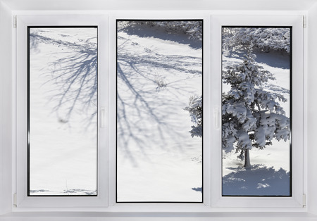 View of the winter landscape through a plastic window