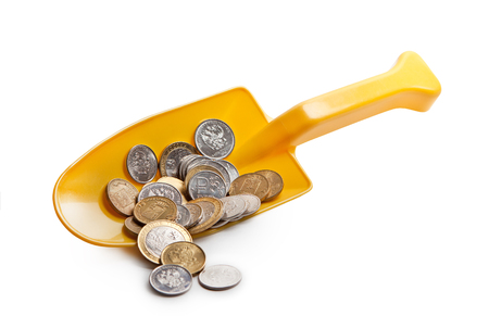 Coins Russia in a small yellow shovel on white background