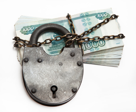 Russian banknotes in a circuit under a large iron lock Stock Photo