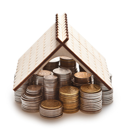 Russian coins are stacked columns and covered with a wooden roof from the top of the house. Dream house.