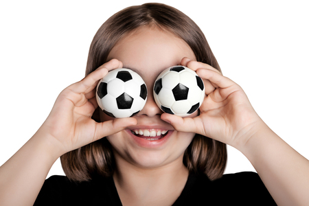 Funny girl closed her eyes with soccer balls. Isolated on white background.