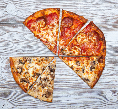 Pizza without mushroom and meat on wooden table.