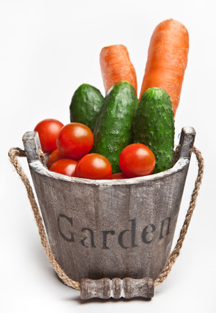 Fresh vegetables in wooden bucket with