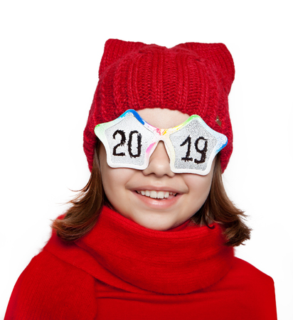 Cheerful girl with glasses with the inscription 2019 on a white background