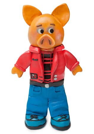 Pig of clay in jeans and a red jacket. Imagens
