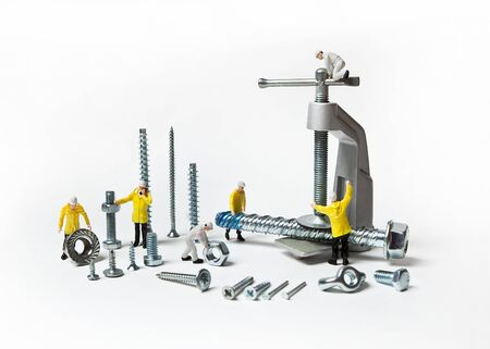Construction crew with mounting material of different calibers on a white background. People are dolls.