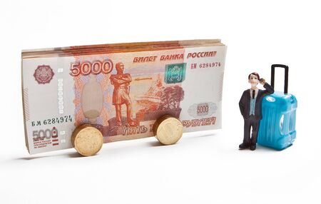 A traveler with a travel suitcase is waiting for boarding a bus from Russian money. The concept of tourism.