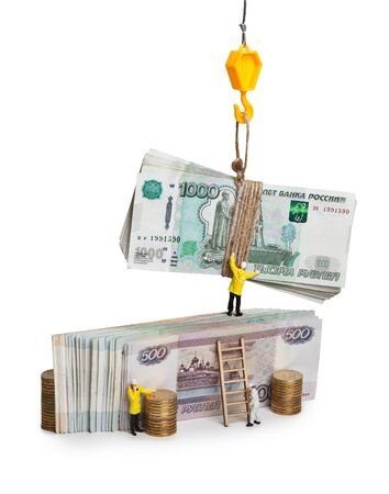 Little people dolls and the big money of Russia. Gain profit. Successful business. Isolated on white background. Imagens