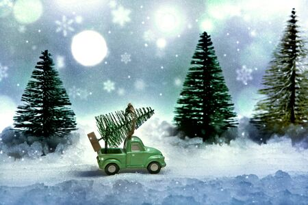 Christmas tree on the truck. Winter evening on the eve of the new year's fairy tale. Miniature.