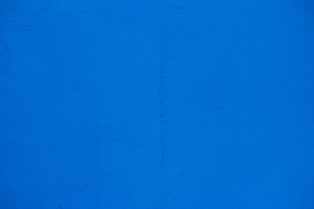 Blue wall texture. Blue painted wall. Crack on the wall. Banco de Imagens