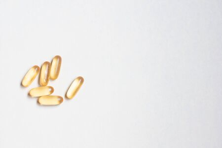 Dietary supplement omega on a white background.Capsule fish oil on a white background. Food supplement omega.