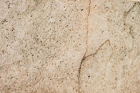 Texture of a stone wall with cracks.